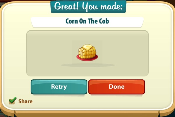 A small corn on the cob with a pat of butter on top of it sits on a red plate