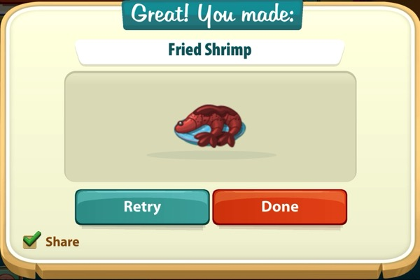A bright red fried shrimp on a small blue plate