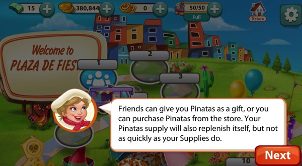 A short blond woman wears a chef hat and a red scarf. She speaks. Behind her is a sign that says Plaza De Fiesta. The Pinatas she mentions are at the top of the screenshot.