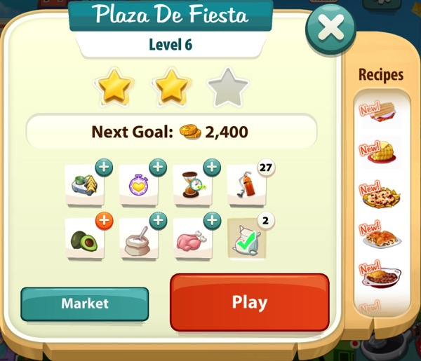 A sign that says Plaza De Fiesta at the top. It shows two gold stars.