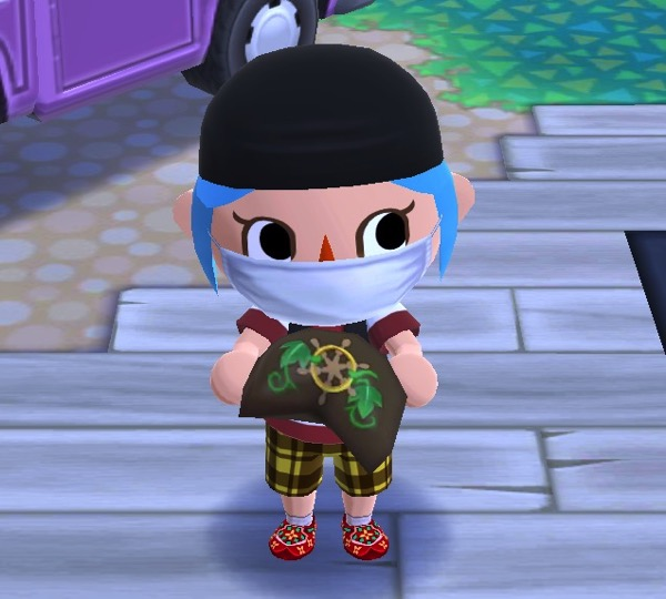 """Close up of my Pocket Camp character still wearing some pirate clothing. They are """"eating"""" Rod's adventure cookie through their mask."""