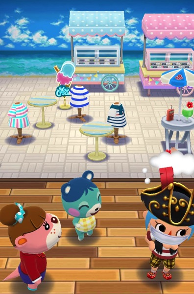 My Pocket Camp character is thinking hard. They stand next to Bluebear and Lottie. In the background is the set up for this class, minus the items the player must set.