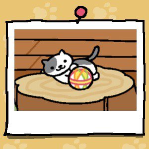 A grey and white cat plays with a fabric ball.