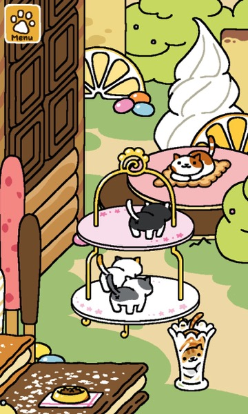 In the background, a cat sits on a mat that looks like a biscuit. One cat is on the top tier of the cake tower, two more are on the bottom tier. One cat is inside a glass vase