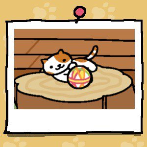 A white cat with orange spots on its face, ears, back, and orange stripes on its tail plays with a fabric ball.