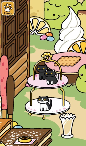 Three black and white cats are on the Tower of Treats.
