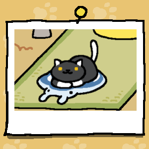 A black cat with yellow eyes, white paws, and a white tail rests on the gel cooling mat that is shaped like a Manta Ray.