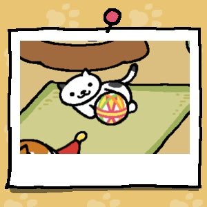 A white cat with small black spots plays with a fabric ball.
