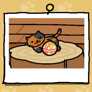 A brown cat with black spots all over its body plays with a fabric ball.