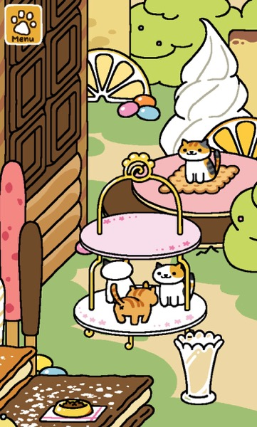 A colorful cat sits on the Biscuit Mat. Three cats share the bottom tier of the Tower of Treats.
