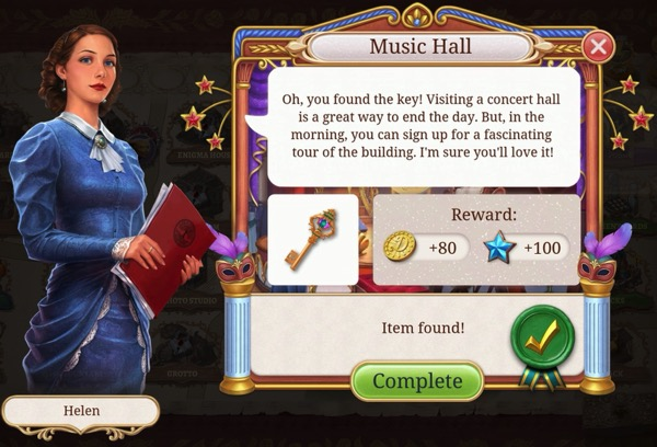 A woman in a blue dress suggests the player visit the Music Hall, now that the key has been located.