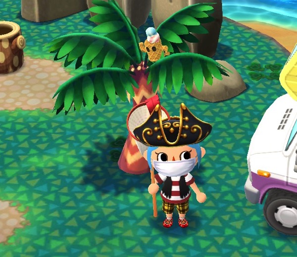 My Pocket Camp character dressed as a pirate. They are standing in front of a palm tree that has a cool scoop gyrodite in it.