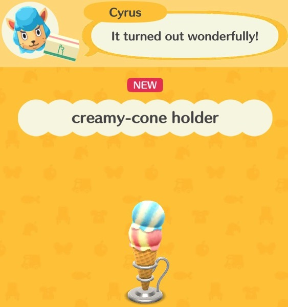 An ice cream cone has two scoops - one with white and blue stripes, and the other with pink and yellow stripes. The cone part is inside a silver cone holder.