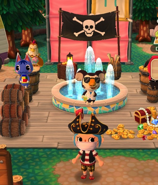My Pocket Camp character wearing pirate clothing stands in front of several of the items that were obtained during the Fishing Tourney. Many animal friends are using them.