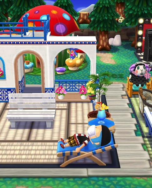 My Pocket Camp character, wearing some pirate clothing, takes a rest on a beach-like chair in the Port Resort section of my campground.