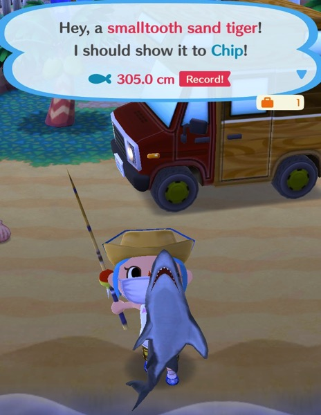 My Pocket Camp character holds up a smalltooth sand tiger.