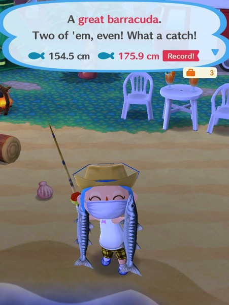 My Pocket Camp character is holding up two great barracudas - one in each hand.