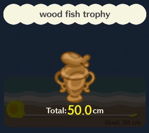 A wooden trophy with a fish on the top of it.