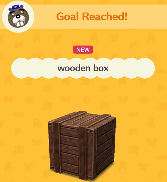 A wooden box that appears to have been made with many small planks of wood on each side.