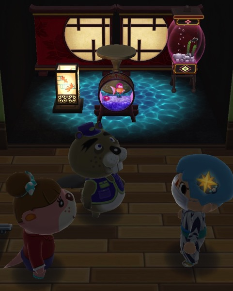 My Pocket Camp character is in the dark, with Chip and Lottie. There are three items from the Fishing Tourney behind them. Those items glow.