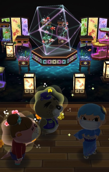 My Pocket Camp character stands near Chip and Lottie. Behind them is a room stuffed full of aquariums and two screens that are decorated with fish.