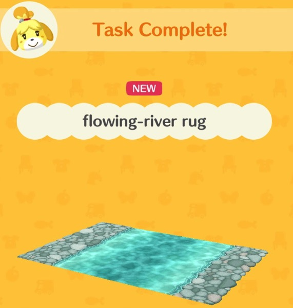 A rug that has rock-like shapes on two of its ends. In the center is part of a flowing river.