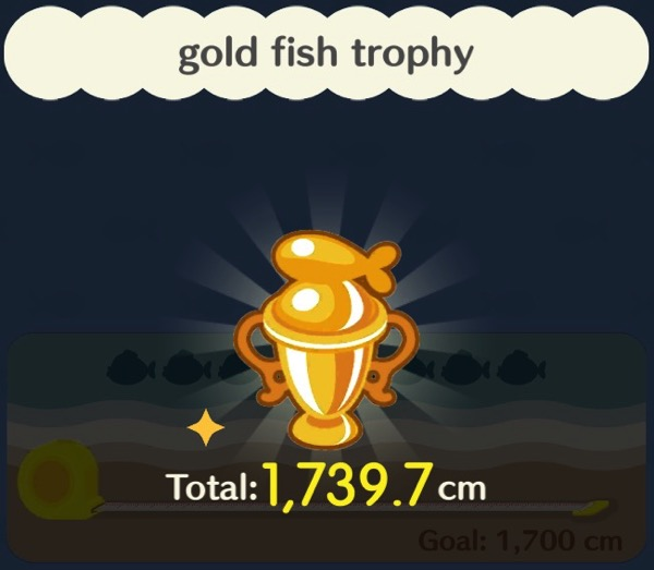 A trophy made out of gold. It has a stylized fish on top of it.