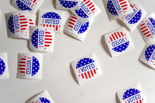 """A photo of a collection of  """"I Voted"""" stickers, scattered around."""