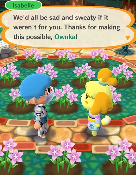 My Pocket Camp character is talking with Isabelle in the campsite garden.