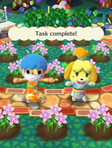 My Pocket Camp character is wearing an orange kimono that hs outlines of fish on it. Isabelle is next to them with a kimono-like outfit.