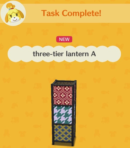 A lantern that is rectangular. It has three different patterns on it. When it is dark outside, this lantern glows.