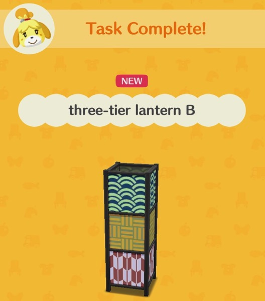 A rectangular lantern with three different designs on it. This lantern glows in the dark at night.