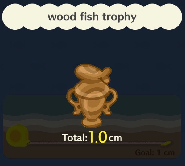 A fishing trophy made out of wood. It has a stylized fish on top of it.