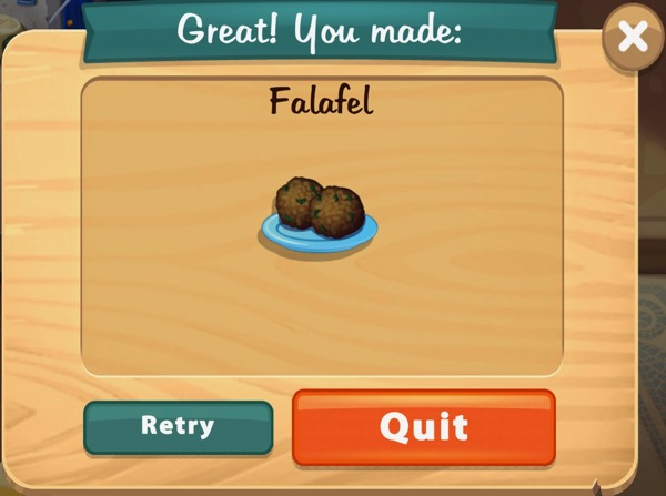 Two balls of Falafel are sitting on a light blue plate.