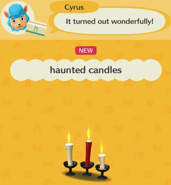 Three Haunted Candles, all in a row. The two outer ones are white, and the middle one is red. All of them are lit.