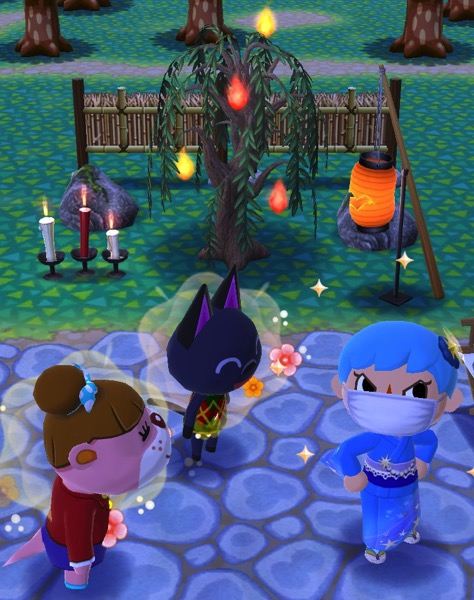 Lottie and Kiki are pleased with the placement of the required items. My Pocket Camp character is making a proud face.