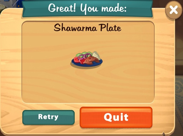 A blue plate is filled with Shwarma, which includes meat, rice, and vegetables.