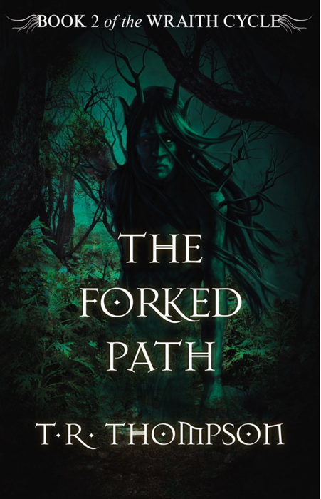 Cover of The Forked Path by T.R. Thompson. The cover is mostly green, with many plants and trees. A green figure with antlers looks out at the viewer.