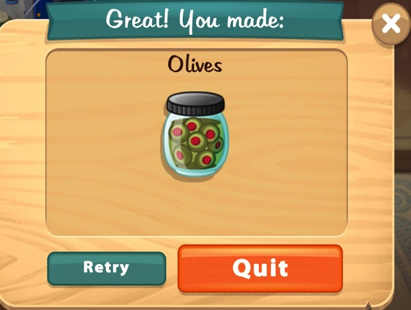 A jar of green olives, each with a red center.